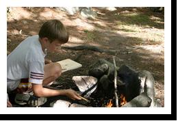 Winona-camper-making-a-campfire-250px
