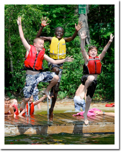 three-winona-campers-jumping-off-dock-400px